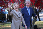 Democratic presidential candidate Hillary Clinton, and her husband former President Bill Clinton, greet supporters after voting in Chappaqua, N.Y. Photo: AP Photo/Seth Wenig