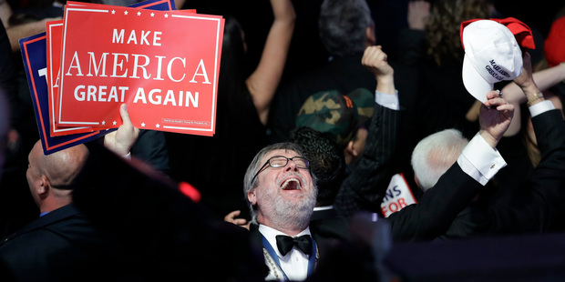 Supporters of Donald Trump react as they watch the election results during Trump's election night rally. Photo / AP