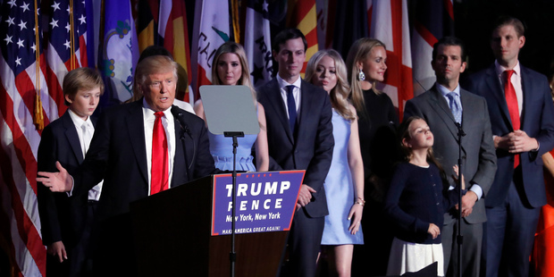 President-elect Donald Trump gives his acceptance speech as he is surrounded by his family at his election night rally, Wednesday, Nov. 9, 2016, in New York. (AP Photo/Mary Altaffer)