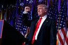 President-elect Donald Trump pumps his fist during an election night rally. Photo / AP