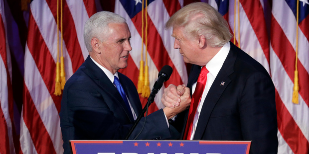 President-elect Donald Trump shakes hands with Vice-President-elect Mike Pence as he gives his acceptance speech during his election night rally. Photo / AP