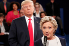Democratic presidential nominee Hillary Clinton, right, speaks as Republican presidential nominee Donald Trump listens during the second presidential debate at Washington University. Photo / AP