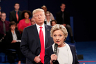 Democratic presidential nominee Hillary Clinton, shadowed by Republican nominee Donald Trump in the second presidential debate. Photo AP