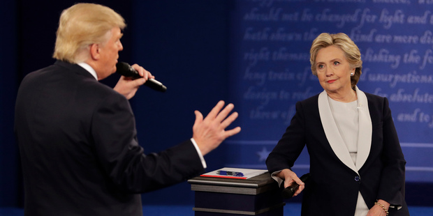 Democratic presidential nominee Hillary Clinton listens to Republican presidential nominee Donald Trump during the second presidential debate. Photo / AP