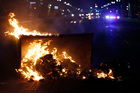 Fire burns in Oakland amid protests over the election of Donald Trump. Photo / AP