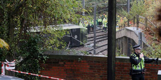 The tram derailed on a sharp corner. Photo / AP