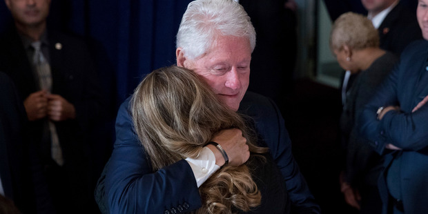 Former President Bill Clinton hugs a woman after his wife, Democratic presidential candidate Hillary Clinton spoke at the New Yorker Hotel in New York. Photo / AP