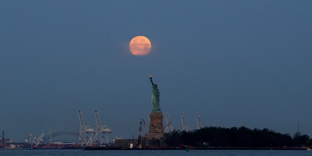 The supermoon over the Statue of Liberty in New York. Photo / AP