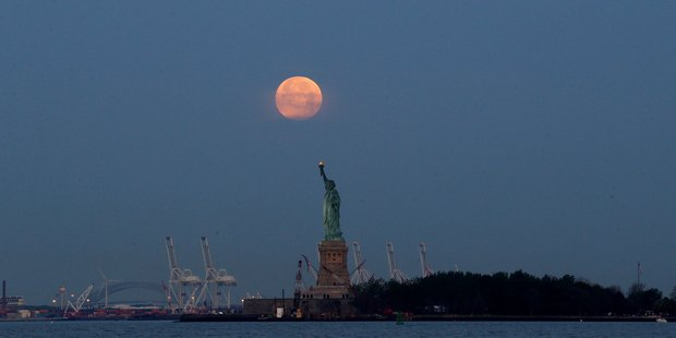 A supermoon over the Statue of Liberty in New York on June 23, 2013.   Photo / AP