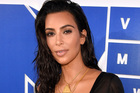 On Keeping Up With the Kardashians, Kim Kardashian told her shocked-looking family she wanted to explore surrogacy. Photo / AP