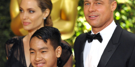 Angelina and Brad with their son Maddox. Photo / AP