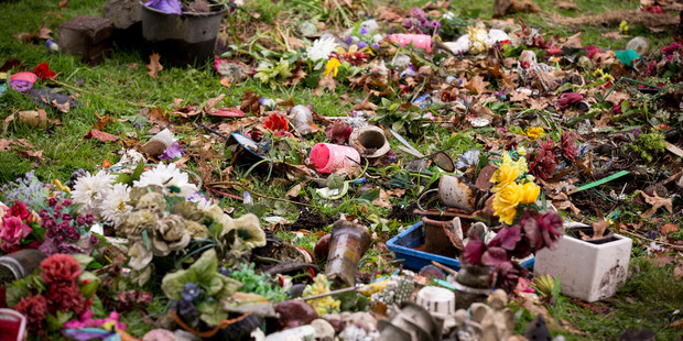 Family members were distraught after the children's section of the Papakura Cemetery was desecrated.Photo/Dean Purcell