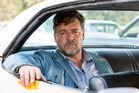 Actor Russell Crowe has kicked his band mates out of his Sydney apartment.