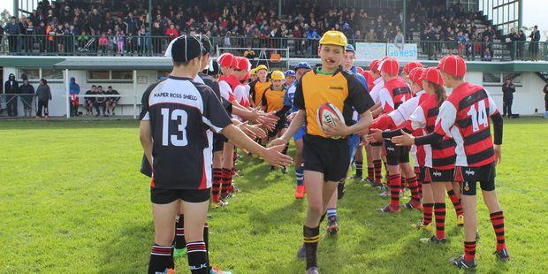 Dannevirke Ross Shield captain Tawera Rautahi leading his team onto Rugby Park
