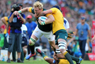 Adriaan Strauss of South Africa tackled by Dean Mumm of Australia. Photo / Photosport