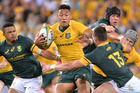Wallabies player Israel Folau attempts to break away from the defence during the Rugby Championship. Photo / Getty Images