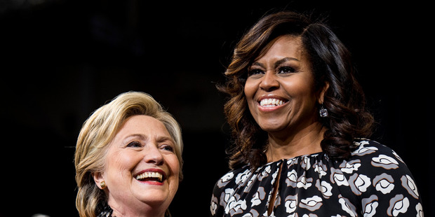 Former Secretary of State Hillary Clinton campaigning in North Carolina with First Lady Michelle Obama. Photo / AP