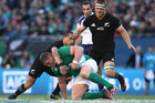 Tadhg Furlong of Ireland is tackled by Aaron Smith during the international match between Ireland and New Zealand at Soldier Field. Photo / Getty Images
