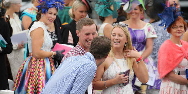 Racegoers enjoying the New Zealand Cup Day at Riccarton Park Racecourse. Photo / Getty Images
