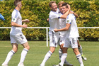 We're back: Saul Halpin (right) is congratulated by Hawke's Bay United teammates. Photo Duncan Brown