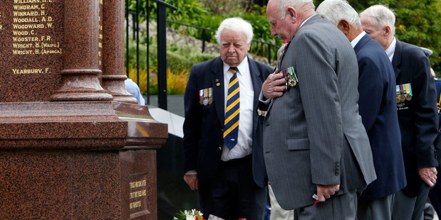 Returned Servicemen Archie Dixon, left and Bill McCoid lead a moment of reflection for those who fell during World War One during Armistice Day commemorations in Whangarei yesterday. PHOTO/JOHN STONE
