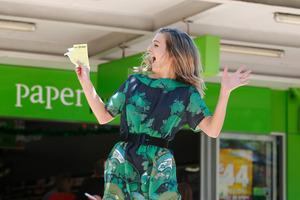 Reporter Alexandra Newlove jumps for joy after buying her first-ever Lotto ticket. Imagine what she'll be like tomorrow if she wins. PHOTO/MICHAEL CUNNINGHAM