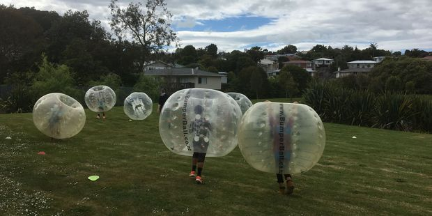 Youngsters zorbing at the NorthTec community day on Sunday.