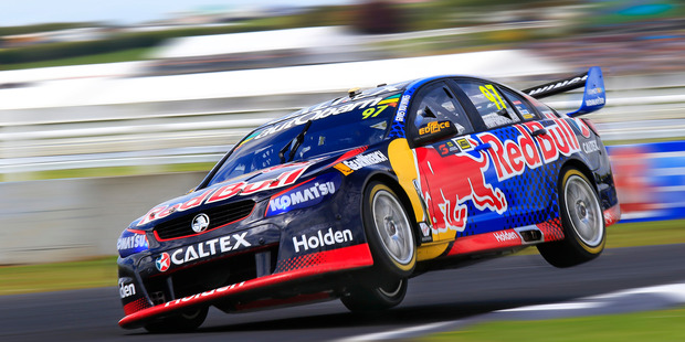 Kiwi Shane van Gisbergen high flying on his way to victory at Pukekohe last weekend. Photo / Greg Henderson Photography