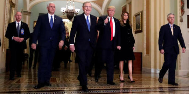 Vice president-elect Mike Pence, Senate Majority Leader Mitch McConnell, President-elect Donald Trump walk to a meeting on Capitol Hill in Washington. Photo / AP