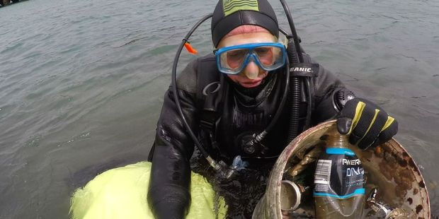 A diver brings up rubbish during the Miramar Wharf clean up last month. Photo/supplied