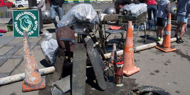 Junk pulled out of the harbour in the 2014 clean up included skateboards, a fire extinguisher, road cones, and an office chair. Photo/supplied