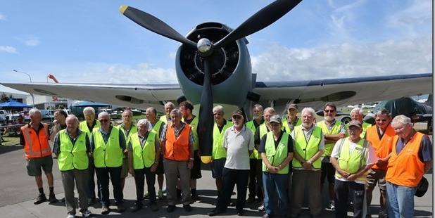 The dedicated restoration team at Classic Flyers who spent two years working on a WWII Avenger torpedo bomber aircraft. Photo/Bent Jansen