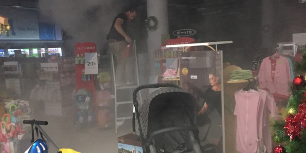 The fire broke out at the Westfield shopping centre in Albany, on the North Shore, about 10.20am. Photo / Supplied