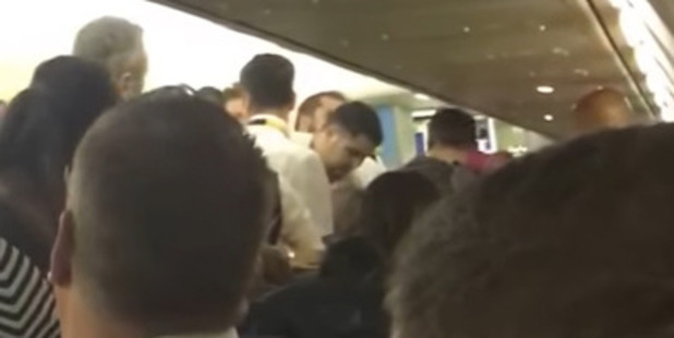 The punch-up was filmed by a shocked passenger who described the men involved as 'Gypsy types'.