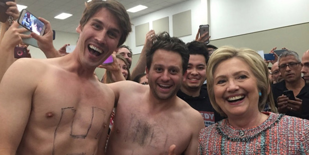 Jason Selvig and Davram Stiefler score a sweet shirtless selfie with Hilary Clinton during the election campaign. Photo/Instagram