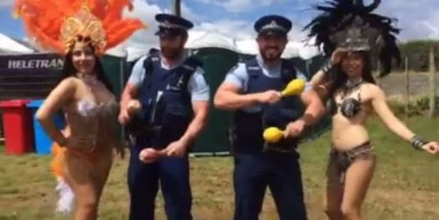 Police officers samba dance with performers at the Pukekohe V8 Supercar event. Photo / Coco Jorge Sequeiros Facbook