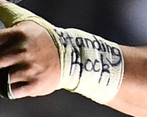 """The words """"Standing Rock,"""" appearing on Kane Hames forearm. Photo / Photosport"""