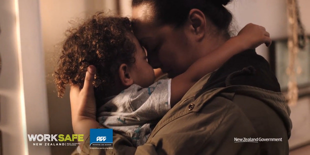 The Worksafe advertisement shows parents hugging their children in workclothes which is how specialists believe Deanna Trevarthen inhaled deadly asbestos fibres. Photo / Worksafe NZ.