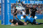 All Blacks prop Wyatt Crockett scores under the posts against Italy. Photo / Brett Phibbs
