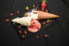 Giapo's Fresh organic Te Horo Strawberry IceCream in a White Chocolate cone and Kerikeri Lemon Sorbet in an original cone. Photo / Greg Bowker