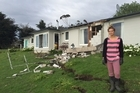 Tessa Prentice, 20, outside her family's quake-damaged home at Claverly in North Canterbury. 