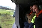 Prime Minister John Key viewing earthquake damage north of Kaikoura from an RNZAF helicopter.  POOL. 14 November 2016. New Zealand Herald photograph by Mark Mitchell