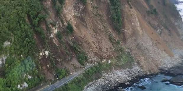 Loading Kaikoura's local MP is considering using a helicopter offered by one of his constituents, as slips and deep cracks shut down transport to the Canterbury town. Photo / Facebook
