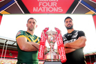 Australian skipper Cameron Smith and Jesse Bromwich of New Zealand with the Four Nations trophy. Photosport