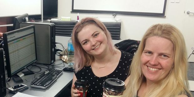 Editorial staff Ilona Hanne and Hannah Walker in their temporary home at the NZME radio office in New Plymouth. After working till the early hours yesterday, they are keeping well caffeinated