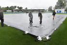 Ground staff clear water from Hagley Oval in Christchurch. Photo / Photosport