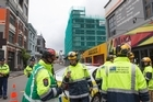 Police and Fire Service staff securing the area around the Reading Cinema Car Park building in Wellington. 17 November 2016. New Zealand Herald photograph by Mark Mitchell