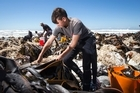 Mike Vincent leads an army of volunteers moving tonnes of Paua from earthquake-raised seabed back into the ocean