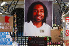 A memorial with a photo of Philando Castile adorns the gate to the governor's residence where protesters demonstrated in St. Paul, Minnesota in July. Photo / AP