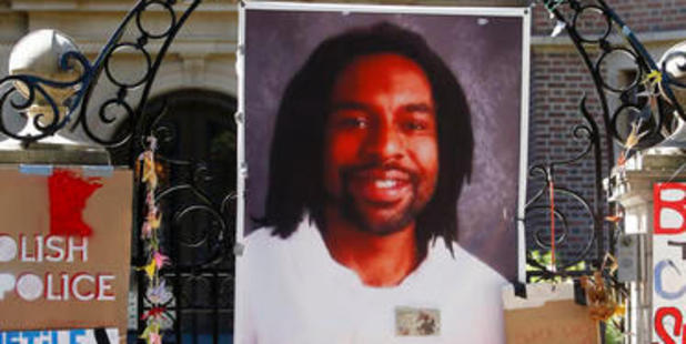 Loading A memorial with a photo of Philando Castile adorns the gate to the governor's residence where protesters demonstrated in St. Paul, Minnesota in July. Photo / AP